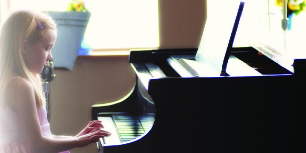 A young Allicia P. performing at a Hamlin Music Recital